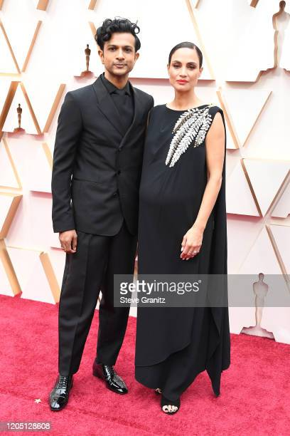 Utkarsh Ambudkar and his wife attends the 92nd Annual Academy Awards at Hollywood and Highland on February 09 2020 in Hollywood California