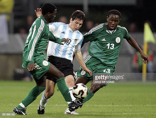 Argentina's Lionel Messi vies with Nigeria's Olubayo Adeemi and Dele Adeleye during the final football match for the FIFA World Youth Championship in...