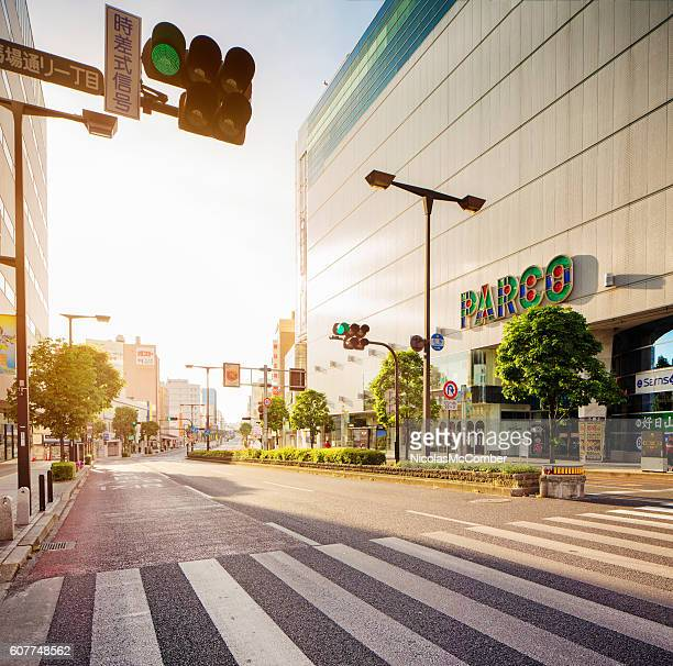 utsunomiya odori street at sunrise with parco department store - 宇都宮市 ストックフォトと画像