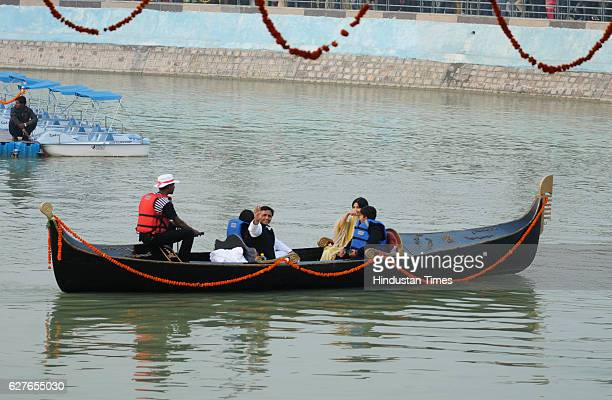 Uttar Pradesh Chief Minister Akhilehsh Yadav and his wife Dimple yadav and Member of Parliament enjoying Gondola ride along with their kids after...