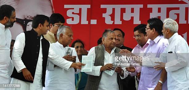 Uttar Pradesh Chief Minister Akhilesh Singh Yadav, Samajwadi Party Chief Mulayam Singh Yadav and other party leaders pay tribute to Ram Manohar Lohia...