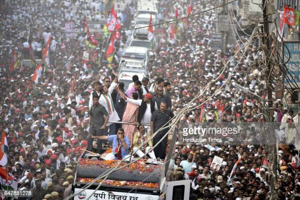 Uttar Pradesh Chief Minister Akhilesh Yadav his wife Dimple and Congress vicepresident Rahul Gandhi during their road show on March 4 2017 in...