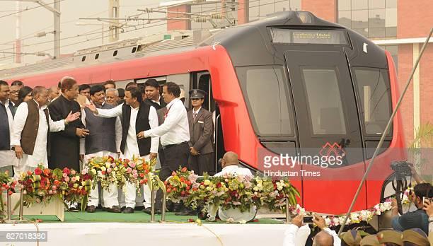 Uttar Pradesh Chief Minister Akhilesh Yadav Samajwadi Party supremo Mulayam Singh Yadav Azam Khan and Shivpal yadav at start of trial run of Lucknow...