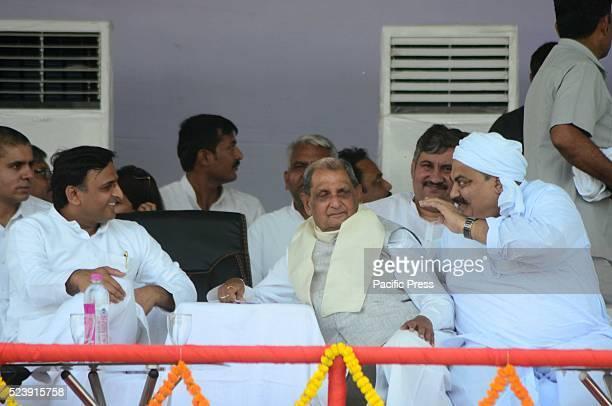 Uttar Pradesh Chief minister Akhilesh Yadav Senior leader Rewati Raman Singh and alleged Mafia and leader Atiq Ahmed during a rally at Iradatganj...