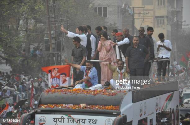 Uttar Pradesh Chief Minister Akhilesh Yadav wife Dimple Yadav and Congress vicepresident Rahul Gandhi during the road show on March 4 2017 in...