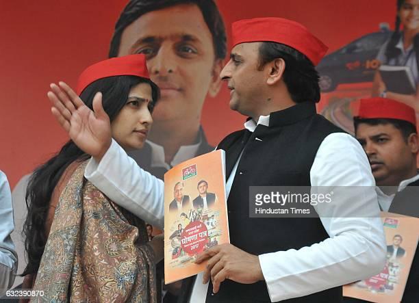Uttar Pradesh Chief Minister Akhilesh Yadav with his wife and Lok Sabha MP Dimple Yadav releases a manifesto of Samajwadi Party during his press...