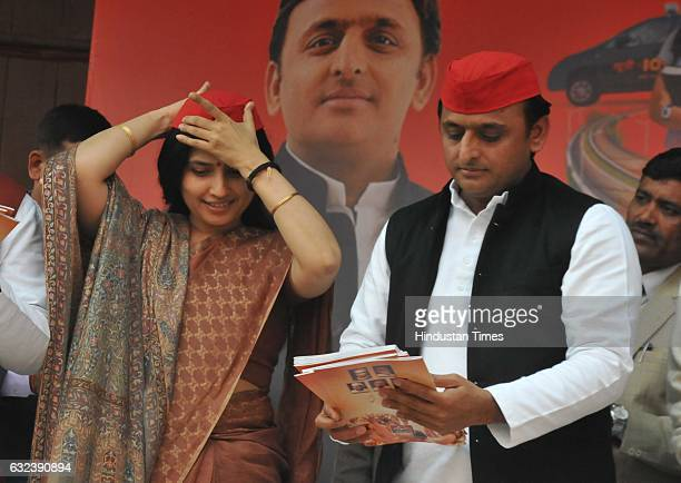 Uttar Pradesh Chief Minister Akhilesh Yadav with his wife and Lok Sabha MP Dimple Yadav releases a manifesto of Samajwadi Party during his press...