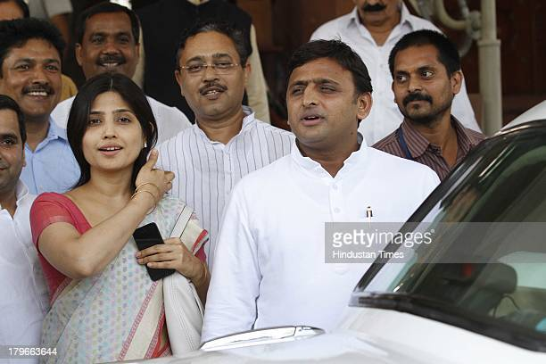 Uttar Pradesh Chief Minister Akhilesh Yadav with his wife Dimple Yadav leave after attending the ongoing monsoon session at Parliament House on...