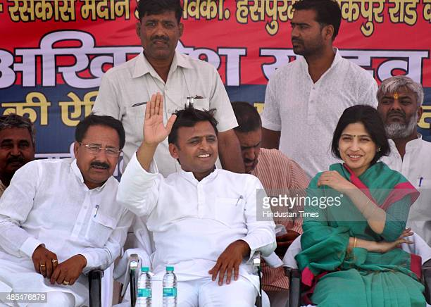 Uttar Pradesh Chief Minister Akhilesh Yadav with wife Dimple Yadav during an election rally in support of Samajwadi party candidate from Akbarpur...