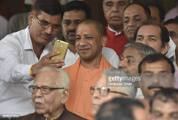 Uttar Pradesh chief minister Yogi Adityanath along with Ram Naik Governor of Uttar Pradesh after the Newly president Ramnath Kovind Oath ceremony at...