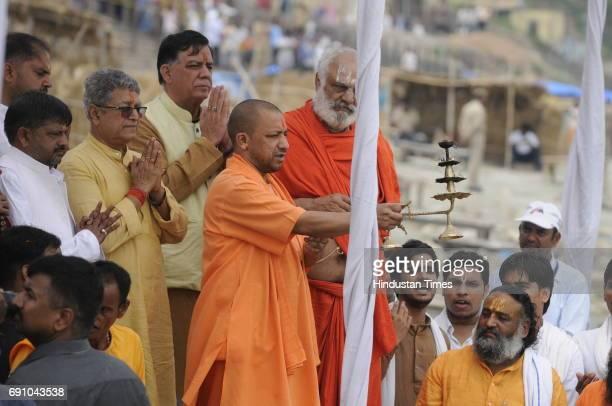 Uttar Pradesh Chief Minister Yogi Adityanath doing arti at Saryu river ghat on May 31 2017 in Ayodhya India On his first visit to Ayodhya UP Chief...