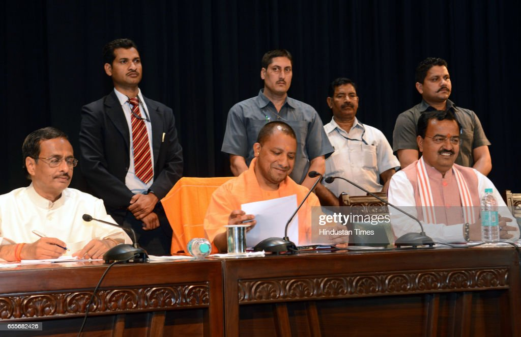 Uttar Pradesh Chief Minister Yogi Adityanath flanked by his deputies Keshav Prasad Maurya and Dr. Dinesh Sharma besides state Chief Secretary Rahul Bhatnagar during his first high-level meeting with senior administrative officers after taking charge, at Lok Bhavan on March 20, 2017 in Lucknow, India.