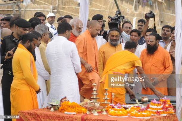 Uttar Pradesh Chief Minister Yogi Adityanath performing arti at Saryu River ghat on May 31 2017 in Ayodhya India On his first visit to Ayodhya UP...