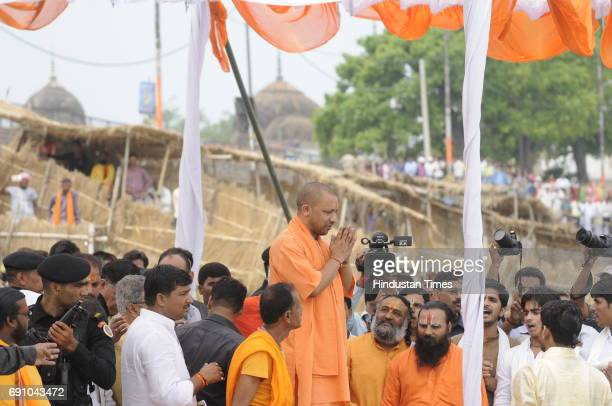 Uttar Pradesh Chief Minister Yogi Adityanath performing arti at Saryu River ghat on May 31 2017 in Ayodhya India On his first visit to Ayodhya UP...