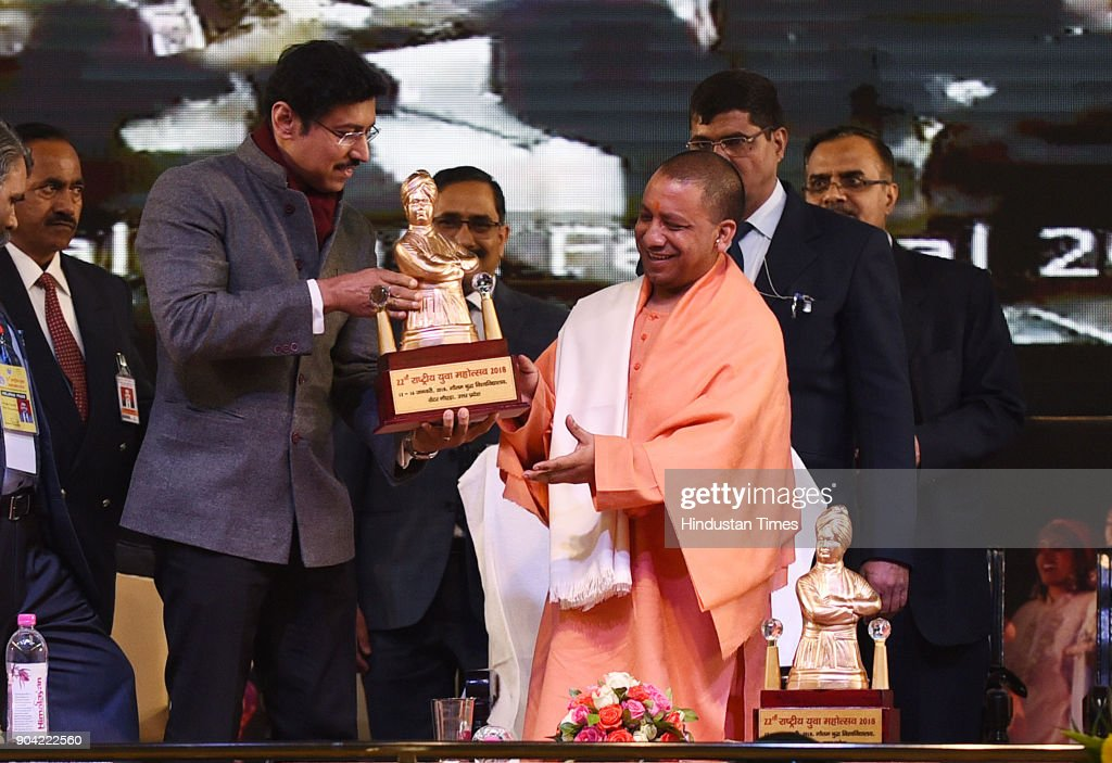 Uttar Pradesh Chief Minister Yogi Adityanath receiving Small statue of Swami Vivekanand by Cabinet Minister of Youth Affairs and Sports Rajyavardhan Singh Rathore during the 22nd National Youth Festival at Gautam Buddha University, on January 12, 2018 in Greater Noida, India.
