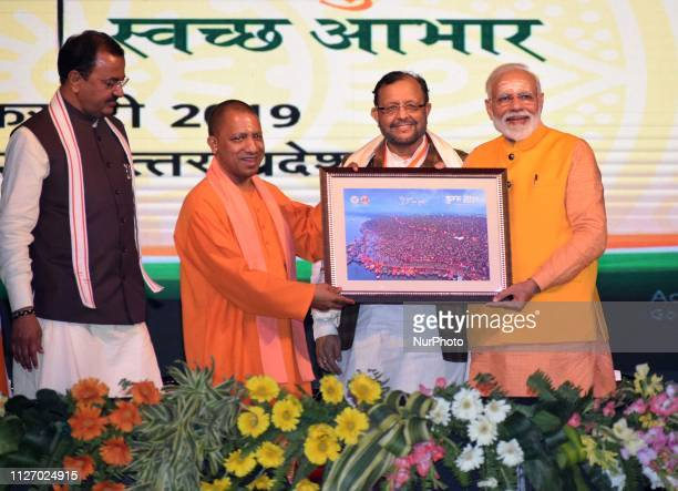 Uttar Pradesh Chief Minister Yogi Adiyanath photograph of Sangam to Prime Minister Narendra Damodardas Modi during Swachhagrahi Samman Samaroh and...