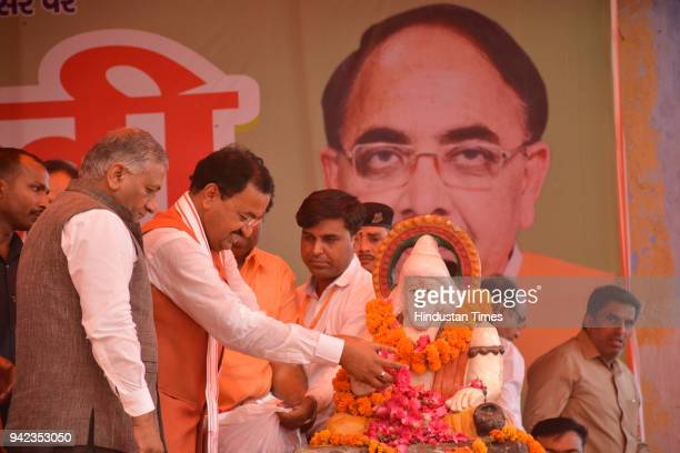 Uttar Pradesh Deputy Chief Minister Keshav Prasad Maurya along with Union Minister and MP General Vijay Kumar Singh and others at an event to...