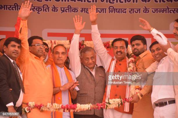 Uttar Pradesh Deputy Chief Minister Keshav Prasad Maurya along with Union Minister and MP General Vijay Kumar Singh and Satpal Singh at an event to...