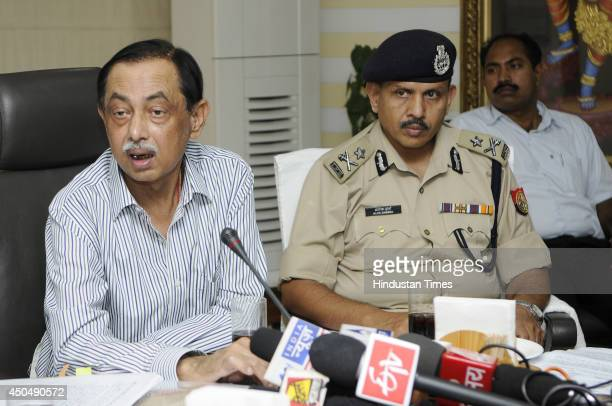 Uttar Pradesh DGP Anand Lal Banerjee and IG Meerut zone Alok Sharma during a press conference at Noida authority office on June 11 2014 in Noida India