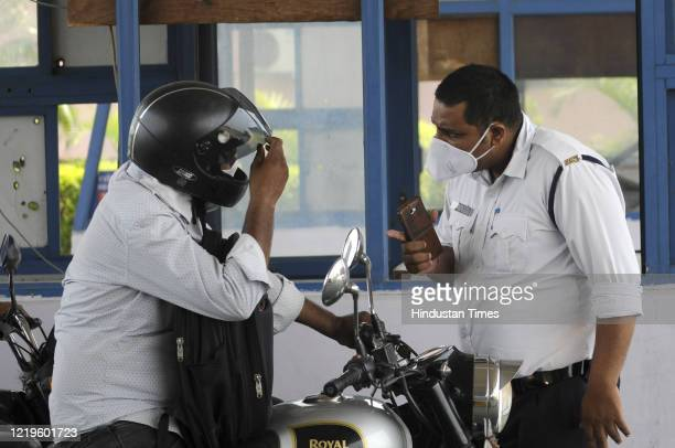Uttar Pradesh police personnel screening commuters at the DND toll plaza along Uttar Pradesh-Delhi border, on June 10, 2020 in Noida, India.