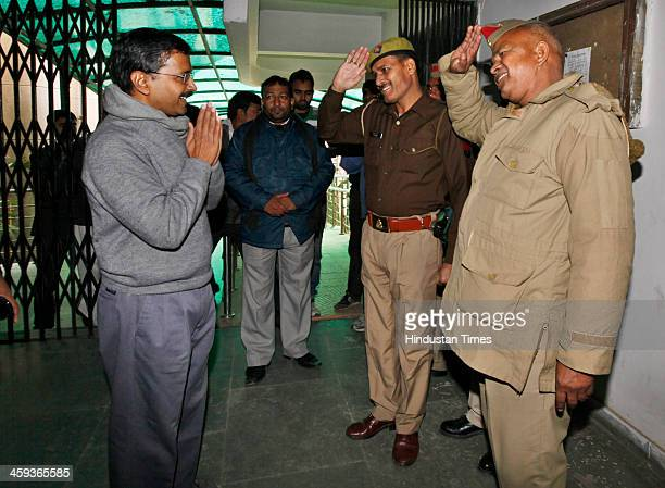 Uttar Pradesh policemen salute to AAP leader and Delhi Chief Minister designate Arvind Kejriwal after the public meeting at his party office...