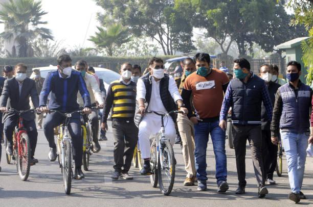 IND: Uttar Pradesh Power Minister Shrikant Sharma Cycles During A Survey In Noida