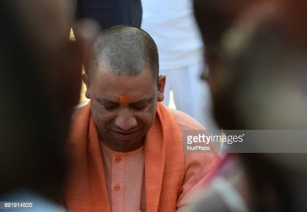 Uttar Pradesh state chief minister Yogi Adityanath performs Ganges river prayers and rituals at holy sangam confluence of Ganges Yamuna and mythical...