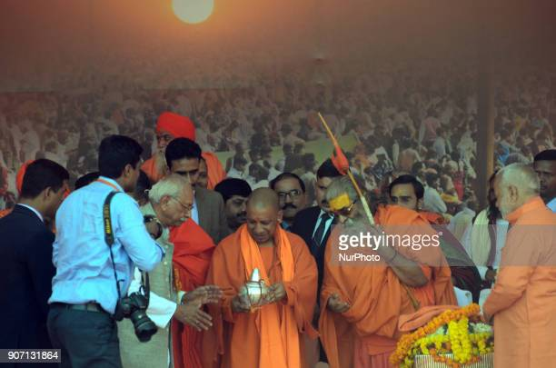 Uttar Pradesh state Chief Minister Yogi AdityaNathrecieves 'Kumbh Kalash ' during Vishwa Hindu Parishad 's Saint Summit in Magh Mela in Allahabad on...