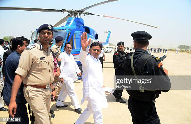 Uttar Pradesh's Chief Minister Akhilesh Yadav shakes hand before leaving during a public rally in Allahabad on April 232016 Mr CM inauguarted various...