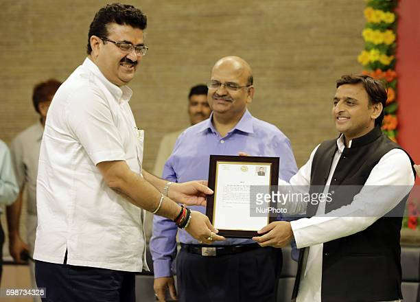 Uttar Pradesh's Chief minister Mr Akhilesh Yadav presents a citations to IAS Navneet Sehgal for his contribution in building Agra Lucknow express way...