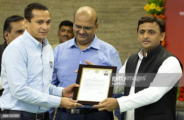 Uttar Pradesh's Chief minister Mr Akhilesh Yadav presents a citations to IAS Rajshekhar for his contribution in building Agra Lucknow express way...