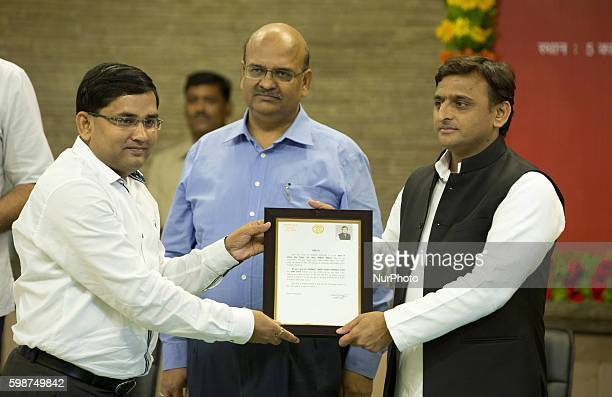 Uttar Pradesh's Chief minister Mr Akhilesh Yadav presents a citations to IAS Anuj Jha for his contribution in building Agra Lucknow express way...