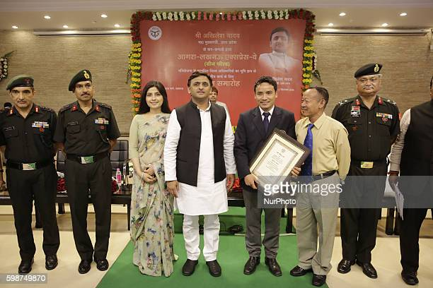 Uttar Pradesh's Chief minister Mr Akhilesh Yadav presents a citations to Khel Ratna Awardee army sports man Shooter Jitu Rai for his contribution in...