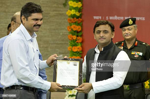 Uttar Pradesh's Chief minister Mr Akhilesh Yadav presents a citations to IAS Pankaj Kumar for his contribution in building Agra Lucknow express way...