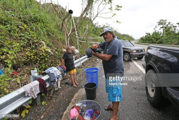 Utuado residents and recovery patient of leptospirosis Wilfredo Cosme de Jesus and his wife Maria Rodriguez Rivera washing their clothes on the side...