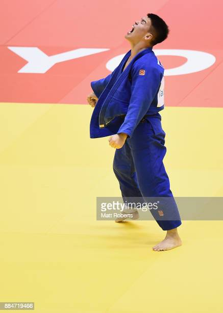 Uuganbaatar Otgonbaatar of Mongolia celebrates victory in the Men's 81kg Final against Sungho Lee of South Korea during day two of the Judo Grand...