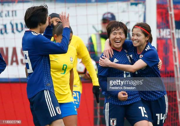 Uuka Momiki of Japan congratulates teammate Yui Hasegawa on scoring a goal during the 2019 SheBelieves Cup match between Brazil and Japan at Nissan...