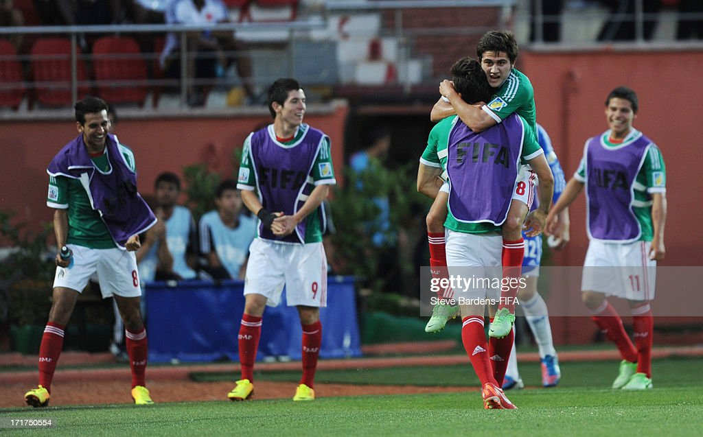 Uvaldo Luna of Mexico (2nd R) celebrates his goal with the Mexico substitutes during the FIFA U20 World Cup Group D match between Mali and Mexico at Kamil Ocak Stadium on June 28, 2013 in Gaziantep, Turkey.