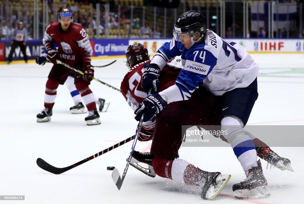 Uvis Balinskis (L) of Latvia and Antti Suomela of Finland battle for the puck during the 2018 IIHF Ice Hockey World Championship group stage game between Latvia and Finland at Jyske Bank Boxen on May 6, 2018 in Herning, Denmark.