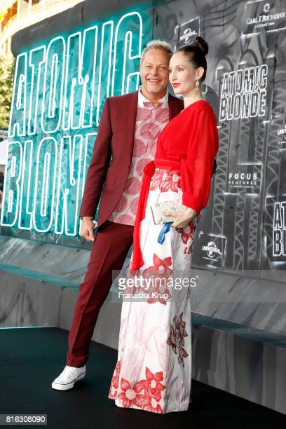 Uwe FahrenkrogPetersen and his partner Christin Dechant attend the 'Atomic Blonde' World Premiere at Stage Theater on July 17 2017 in Berlin Germany