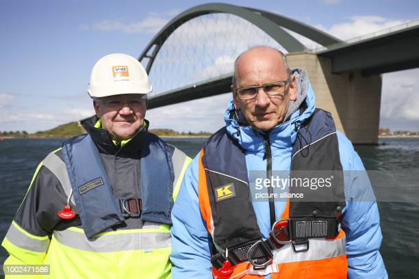 Uwe Fresenborg from the Vulhop Becker company and Bernd Homfeldt project leader from Deutsche Bahn standing on a drilling platform on the waters of...