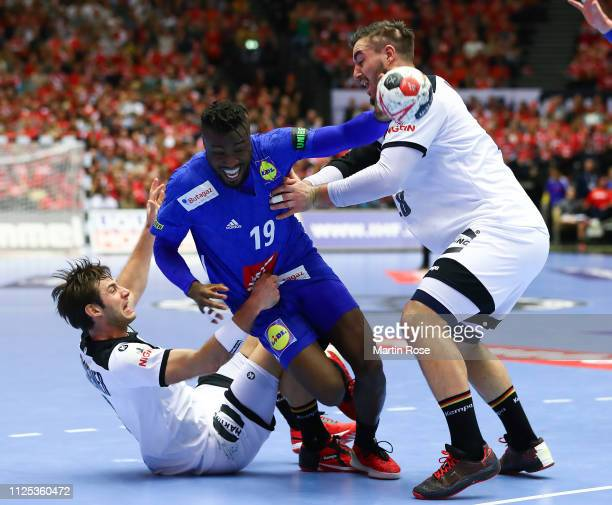 Uwe Gensheimer and Jannik Kohlbacher of Germany challenge Luc Abalo of France during the 26th IHF Men's World Championship 3rd place match between...
