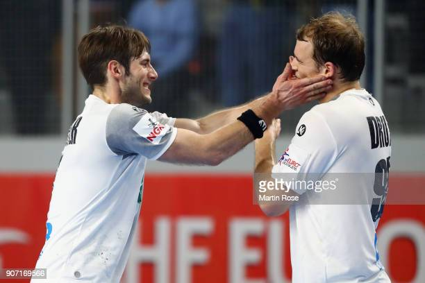 Uwe Gensheimer and Paul Drux of Germany celebrate after the Men's Handball European Championship main round group 2 match between Germany and Czech...