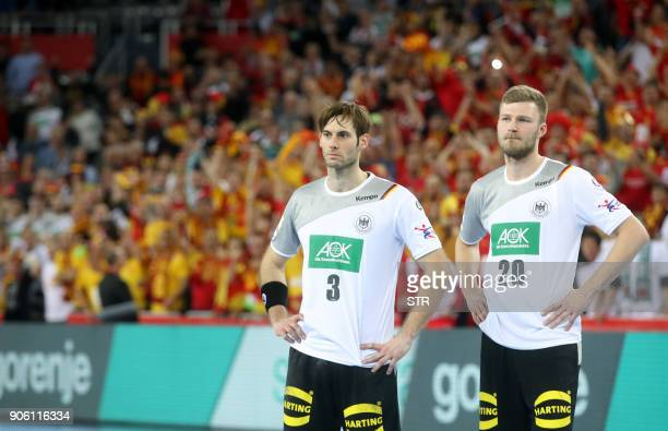 Uwe Gensheimer and Philipp Weber of Germany look on at the end of the preliminary round group C match of the Men's 2018 EHF European Handball...
