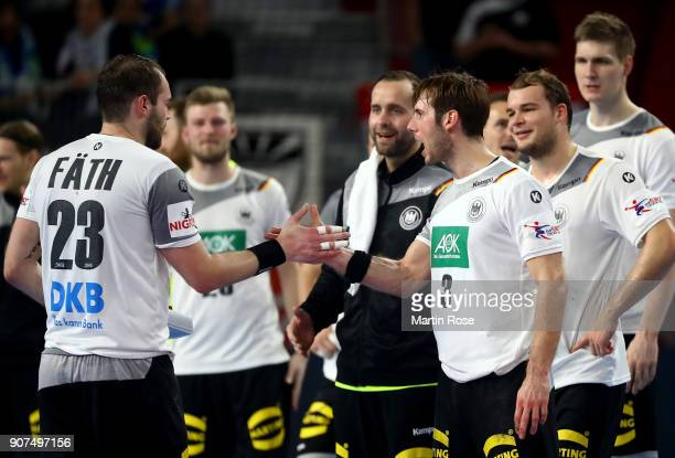 Uwe Gensheimer of Germany celebrate with team mate Steffen Faeth after the Men's Handball European Championship main round match between Germany and...