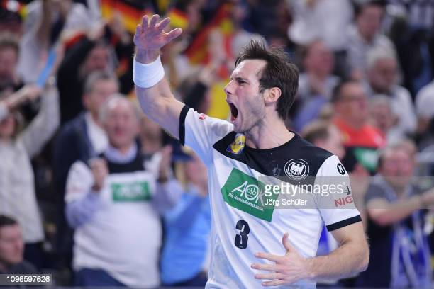 Uwe Gensheimer of Germany celebrates a goal during the 26th IHF Men's World Championship group 1 match between Germany and Iceland at Lanxess Arena...