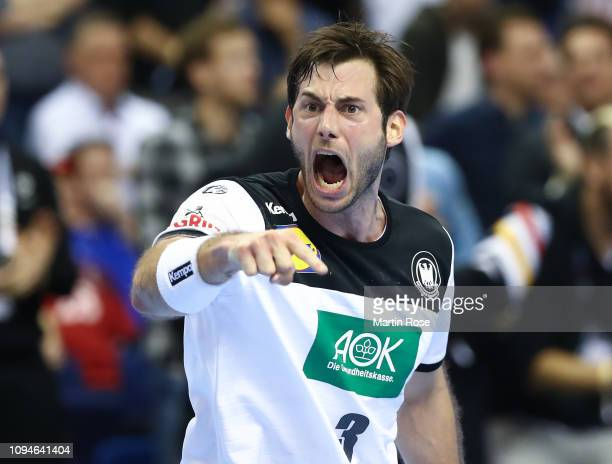 Uwe Gensheimer of Germany celebrates during the 26th IHF Men's World Championship group A match between Germany and France at MercedesBenz Arena on...
