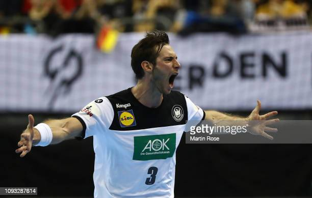 Uwe Gensheimer of Germany celebrates scoring a goal during the 26th IHF Men's World Championship group A match between Germany and Brazil at...