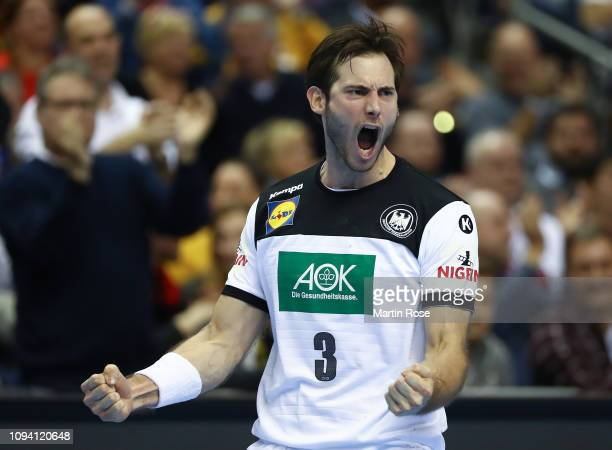 Uwe Gensheimer of Germany celebrates scoring a goal during the 26th IHF Men's World Championship group A match between Russia and Germany at...
