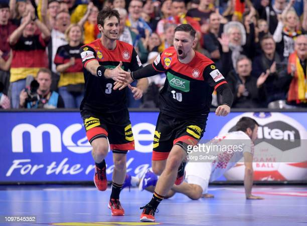 Uwe Gensheimer of Germany celebrates with Fabian Wieder of Germany during the 26th IHF Men's World Championship group 1 match between Croatia and...